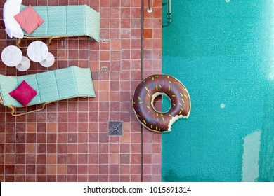 Swimming Pool at Luxury Villa Hotel with Terracotta Ceramic Tile paving Donut and Sunbed. Top View.