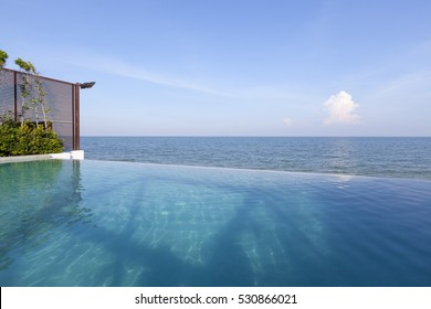 Swimming pool near the beach with blue sky at high class resort