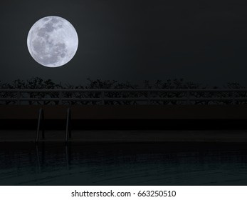Swimming pool at night with full moon in darkness sky