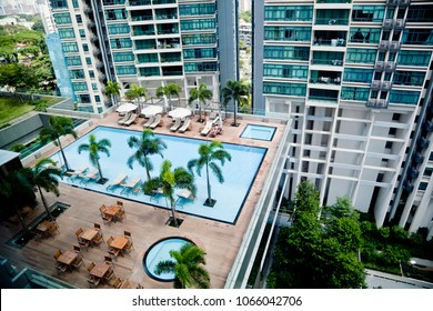 A swimming pool on the roof among the skyscrapers