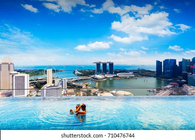 Swimming pool on roof top with beautiful city view, Singapore city skyline