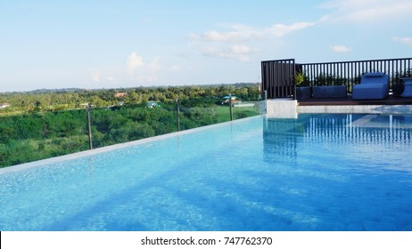 The swimming pool on rooftop at luxury hotel