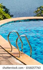 Swimming pool on a sunny day near the sea in island Koh Phangan, Thailand