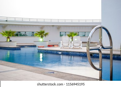 Swimming pool on the top of the roof in modern residential building in Dubai. Modern building architecture design for luxury hotel building. Terrace outdoor pool on top of skyscraper.