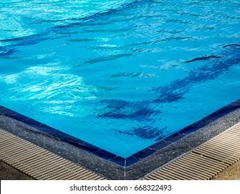 Swimming pool overflow grating.