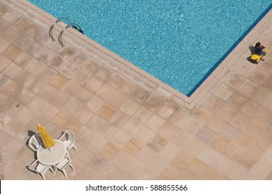 Swimming pool with playing child