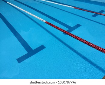 SWIMMING POOL WITH RACE TRACK LANES , CLEAR AQUA WATER