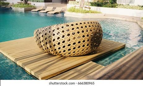 Swimming pool with rattan sofa
