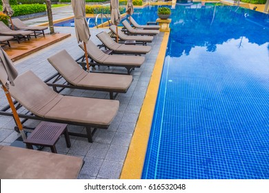 Swimming pool with relaxing seats near the sea