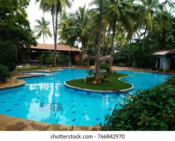 Swimming Pool in Resort with Green Background Flowers with Huts