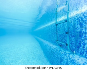 Swimming pool stair from under water view