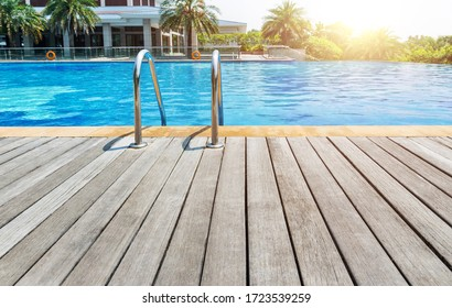 Swimming pool with stair and wooden deck.