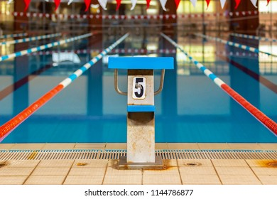 Swimming pool starting block with number on it.