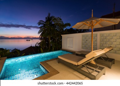 Swimming pool with sunset view at Regent Phuket Cape Panwa, Phuket, Thailand.