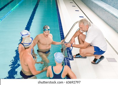 Swimming pool - swimmer training competition in class with coach