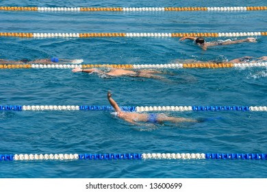 Swimming pool with swimmers training