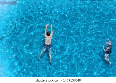Swimming pool top view angle which blue color clear water and sun light reflect on surface texture and concept images for relaxation or vacation or sport in the tropical summer and for healthy