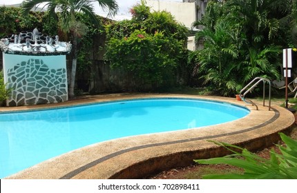 Swimming pool in a tropical garden
