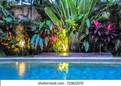Swimming pool with tropical garden and turquoise water