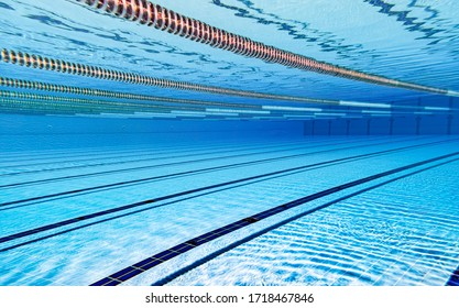 Swimming pool underwater blue background.