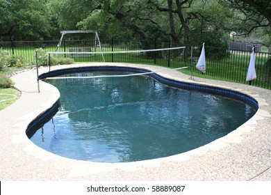 Swimming pool with volleyball net in a backyard
