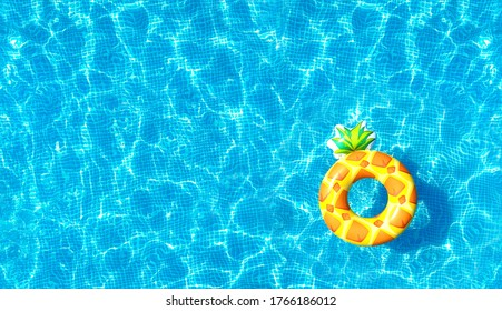 Swimming pool water texture background with inflatable pineapple toy. Directly above. Top view from drone.