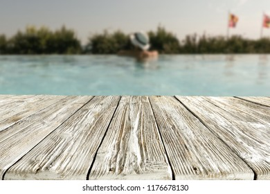 swimming pool and wooden table on a holiday day