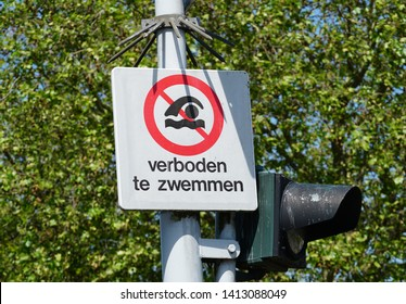 Swimming Prohibited or Swimming not allowed sign in Dutch language.