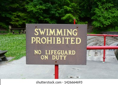 Swimming Prohibited Sign at a Swimming Hole in Buttermilk State Park, Ithaca New York