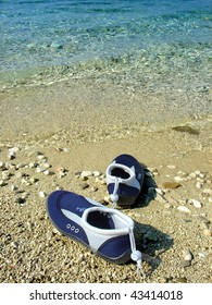 swimming shoes on the beach