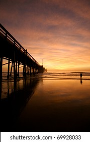 Swimming under dramatic sunset skies at the pier
