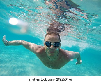 Swimming under the water in a clear sea