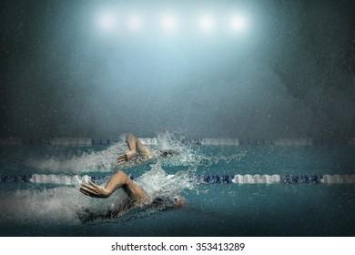 Swimming in waterpool.