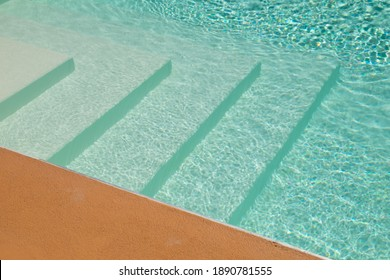 swimmingpool with stairs and turquoise water