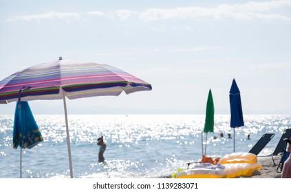 swimming,sea,sky, and sun umbrellas