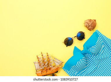a swimsuit, glasses on a bright yellow background. Everything for rest