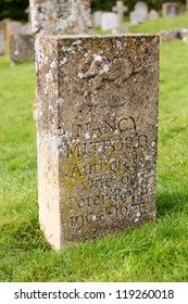 SWINBROOK, ENGLAND - OCT 20: Gravestone for Nancy Mitford, famous Author. She died on 30 June 1973 and was buried in Swinbrook.