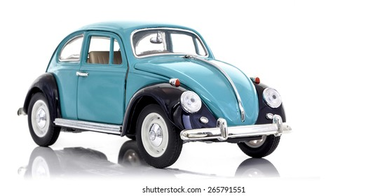 SWINDON, UK - APRIL 1, 2014:  VW Beetle in Blue Die cast model on a white background.