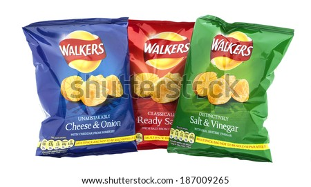 SWINDON, UK - APRIL 13, 2014:  Three packets of Walkers crisps  isolated on a white background. Walkers is a British snack food manufacturer