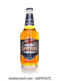 SWINDON, UK - APRIL 30, 2017: Bottle of Spitfire Kentish ale on a white background, Spitfire is brewed and bottled by Shepherd Neame Faversham Kent England UK