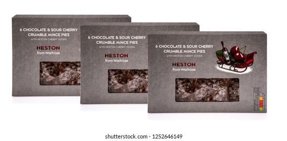 SWINDON, UK - DECEMBER 2, 2018:  Heston From Waitrose 6 Chocolate and Sour Cherry Crumble Mince Pies with Heston Cherry Vodka on a white background