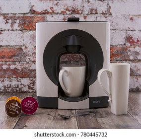 SWINDON, UK - DECEMBER 23, 2017: Nescafe Dolce Gusto Coffee Pod System with a KRUPS coffee maker in a rustic kitchen setting.