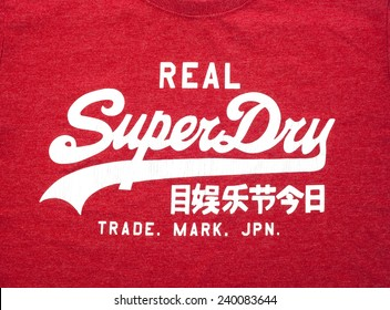 SWINDON, UK - DECEMBER 27, 2014: A  Red Superdry Tee Shirt showing the  Logo.