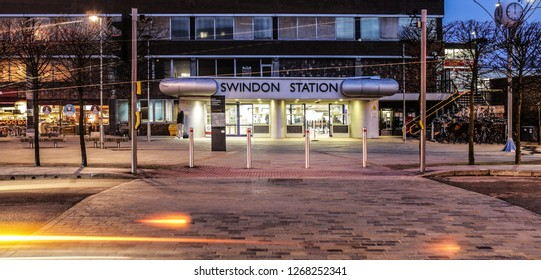 SWINDON, UK - DECEMBER 27, 2018: Swindon Railway Station in Wiltshire at night with light trails