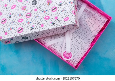 SWINDON, UK - FEBRUARY 11, 2018: Glossybox Cosmetics on a blue textured background