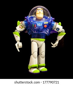 SWINDON, UK - FEBRUARY 19, 2014: Buzz Lightyear from Disney's Toy Story 2 on a Black Background