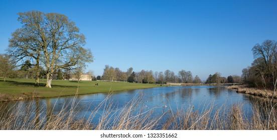 SWINDON, UK - FEBRUARY 24, 2019: Lydiard House and Lake, Lydiard Park  Swindon, Wiltshire, UK