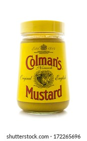 SWINDON, UK - JANUARY 1, 2014: Colemans Classic English Mustard on a white background