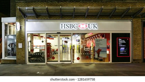 SWINDON, UK - JANUARY 1, 2019: HSBC bank  front in Swindon Town centre by night