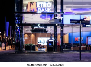 SWINDON, UK - JANUARY 1, 2019: Metro bank  front in the Parade in Swindon Town centre by night